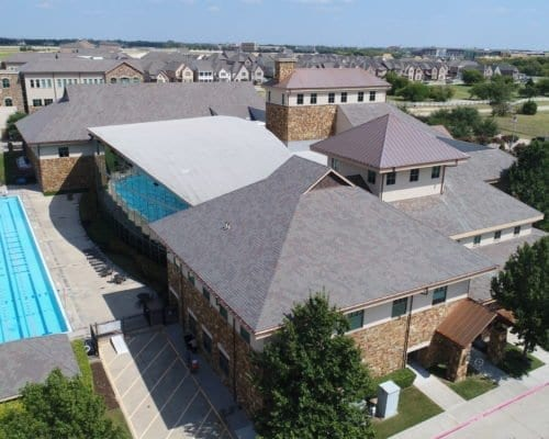 Aerial view of Cooper Fitness Center commercial roofing with pool