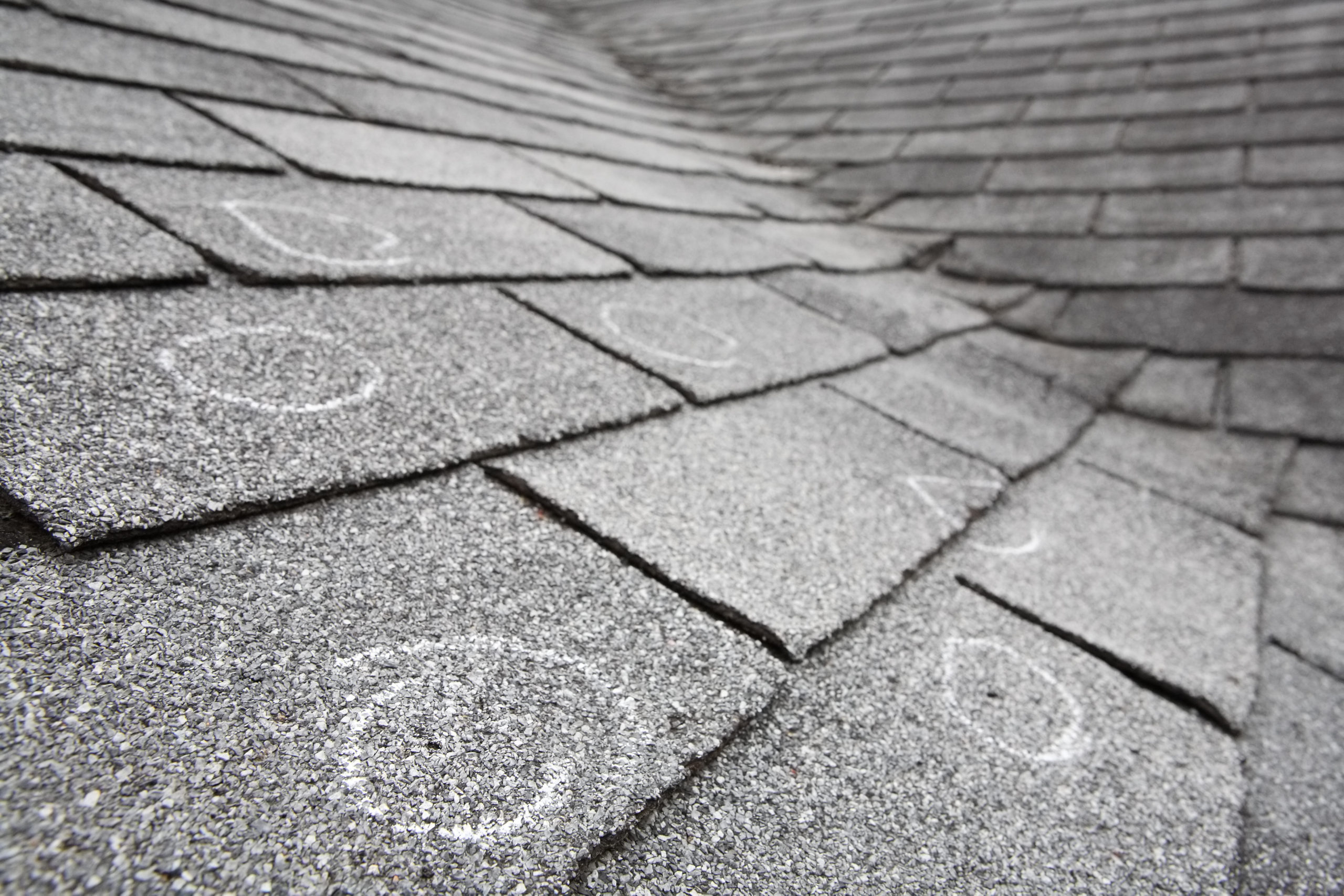 Roof with chalk circles to mark hail damage