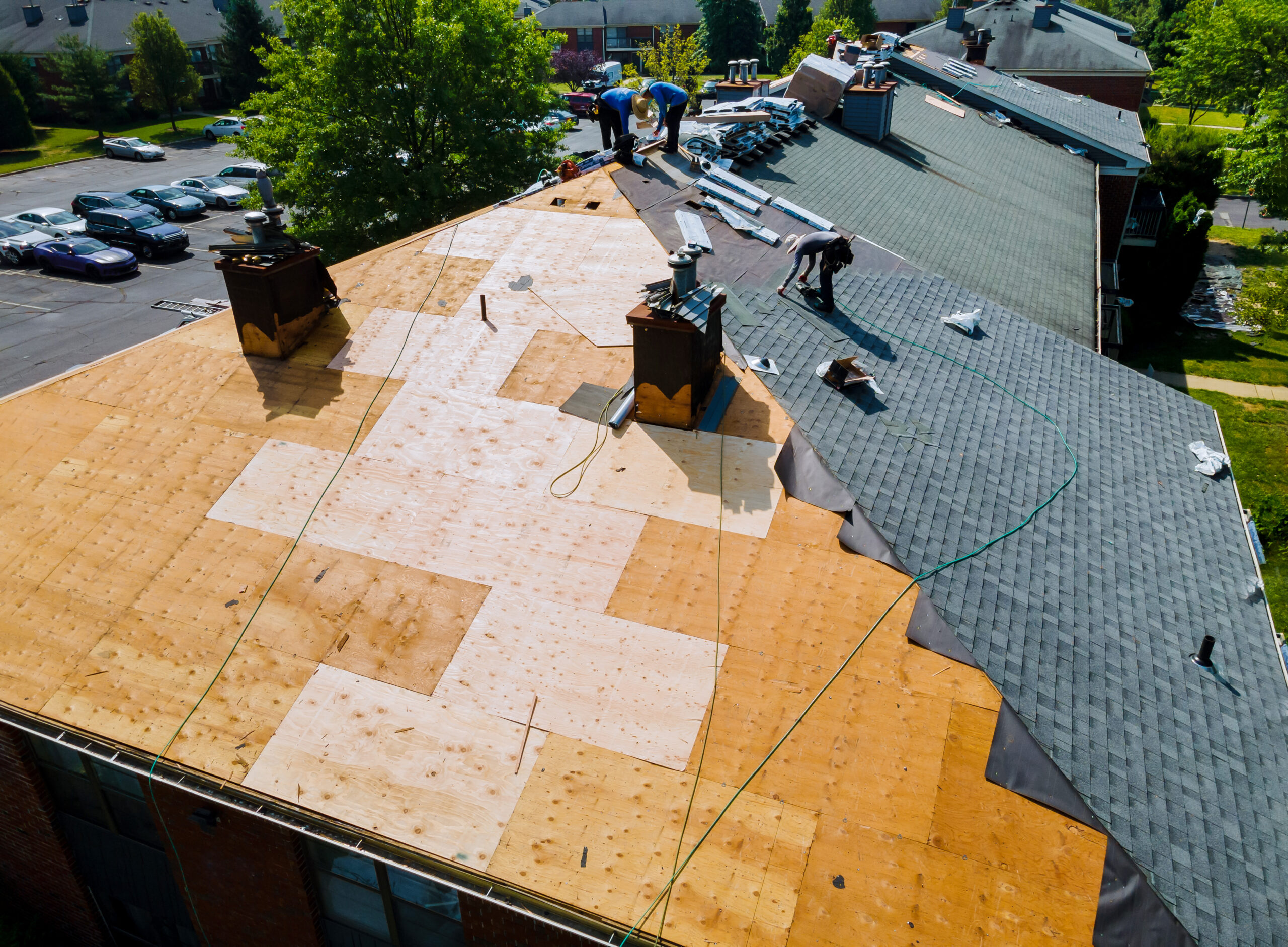 Roofing team replacing a roof